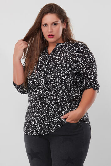 Blusa larga con estampado integral