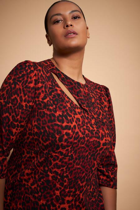 Vestido ajustado con bonita apertura en el pecho y estampado de leopardo