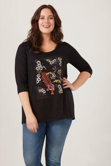 Camiseta con bordados y brillantes