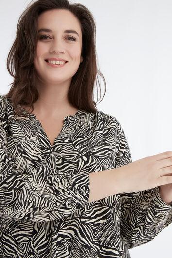 Blusa túnica con estampado de cebra