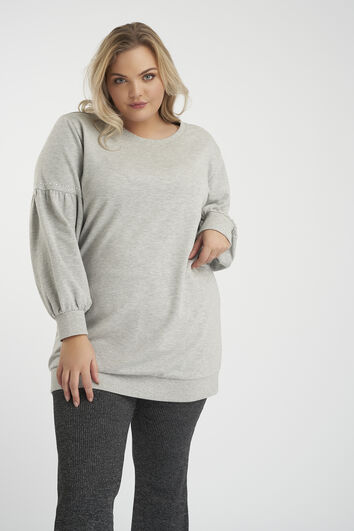 Suéter con mangas abullonadas