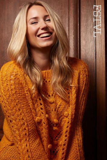 Suéter de punto con pompones