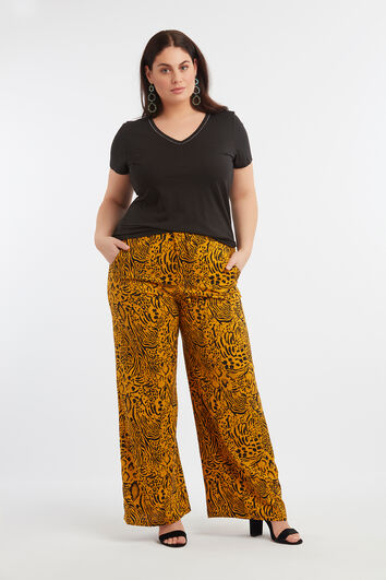 Pantalones de pernera ancha con estampado integral